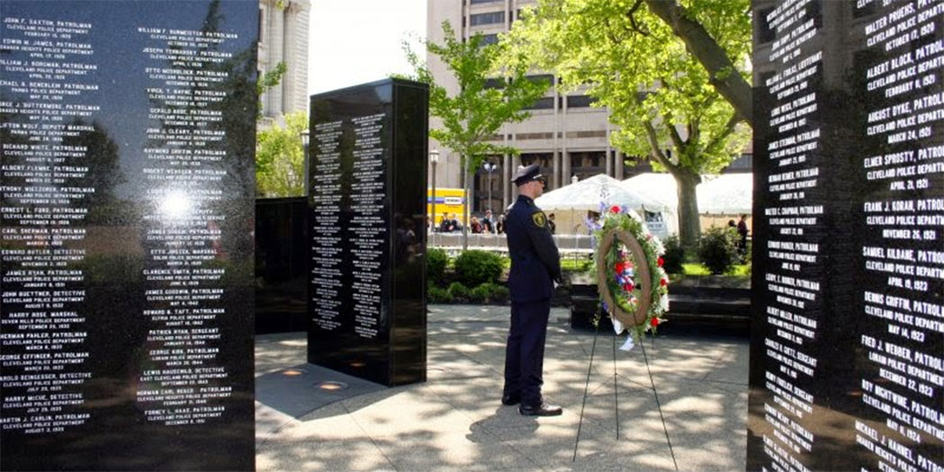 A police officer standing watch at the Cleveland Police Memorial